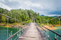 Wooden suspension bridge in Guatape, Colombia Royalty Free Stock Image