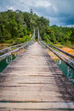 Wooden suspension bridge in Guatape, Colombia Royalty Free Stock Images