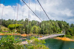 Wooden suspension bridge in Guatape, Colombia Stock Images