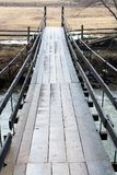 Wooden suspension bridge over mountains forest river royalty free stock image