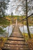 Wooden suspension bridge over the river Stock Image