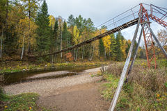 Wooden suspension bridge over the river Royalty Free Stock Image