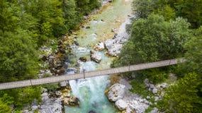 Wooden suspension bridge with river stock photo