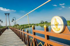 The wooden suspension bridge span that across the small lake at Wareepirom Park. Bangkok, Thailand, The wooden suspension bridge span that across the small lake stock image