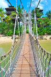Wooden suspension bridge to paradise Stock Images