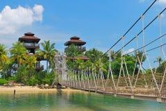 Wooden suspension bridge to paradise Royalty Free Stock Photos
