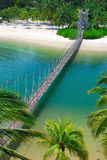 Wooden suspension bridge to paradise island Royalty Free Stock Images