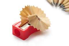 Wooden swarf on sharpener with pencils Royalty Free Stock Photography