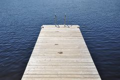 Wooden swimming dock Royalty Free Stock Images
