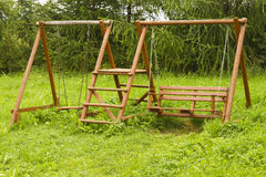 Wooden swing Stock Images