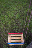 Wooden swing Royalty Free Stock Photo