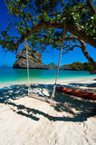 Wooden swing against paradise beach scene Stock Photography