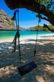Wooden swing against paradise beach scene Stock Images