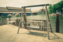 Wooden Swing at Antique Market Stock Photo