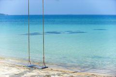 Wooden swing at the beach Stock Photos