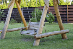 Wooden swing bench Royalty Free Stock Photos