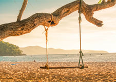 Wooden swing chair near the ocean sunset,chonburi, thailand Stock Images