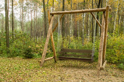 Wooden swing Stock Photography
