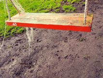Wooden swing Royalty Free Stock Images