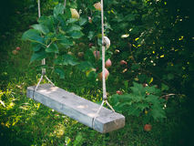 Wooden swing in the garden Stock Photography
