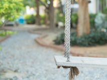 Wooden swing in the garden Royalty Free Stock Photos