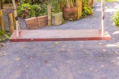 Wooden  swing in garden. Empty wooden  swing in garden Stock Image
