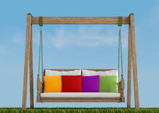 Wooden swing on grass Stock Photo