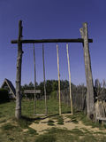 Wooden swing. Mari Ethnographic Museum, Kozmodemyansk, Republic of Mari EL, Russia royalty free stock photography