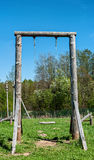 Wooden swing. Older children swings on a thick pole Stock Photography