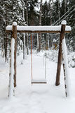 Wooden swing in a pine forest Royalty Free Stock Images