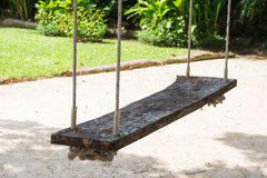 Wooden swing for relaxation in garden Stock Photos