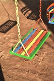 Multi-color painted swing for child on playground Royalty Free Stock Photo