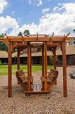 Wooden Swing Set. For swinging while sitting on the bench seats on opposite sides royalty free stock photos