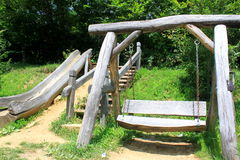 Wooden swing and slide for children Royalty Free Stock Images