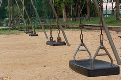 Wooden swing with steel chain. Stock Photo