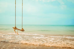 Wooden swing on  tropical beach Royalty Free Stock Photography