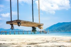 Wooden swing on tropical beach for summer and vacation Royalty Free Stock Image