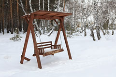 Wooden swing in winter Stock Image
