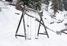 Wooden swing in the winter Stock Photography
