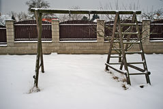 Wooden swing in winter with snow Stock Photo