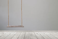 Wooden swing and wood floor. Stock Photos