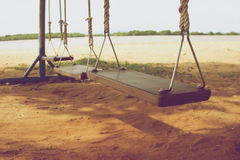 Wooden swings on beach vintage Royalty Free Stock Photography