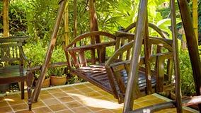 Wooden swings in a cozy park stock video footage