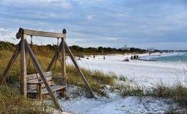 Wooden Swings on honey moon island beach Florida. January 2019, Honeymoon Island, FL - Wooden Swings gently rock on a windy at the honey moon island beach stock image