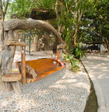 Wooden Swings made of logs Royalty Free Stock Images