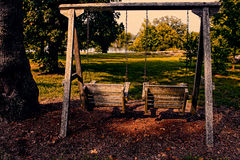 Wooden Swings Near Country Lake Stock Photos