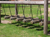 Wooden swings in a playground Royalty Free Stock Photos
