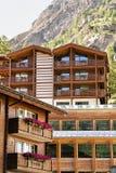 Wooden Swiss chalet in mountains in Zermatt. Wooden Swiss chalet in mountains, Zermatt, Switzerland in summer Stock Image