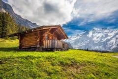 Wooden Swiss chalet in Swiss Alps near Kandersteg and Oeschinnensee, Switzerland, Europe. Royalty Free Stock Photos