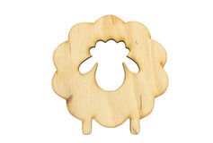 Wooden symbol of sheep. Isolated over white Royalty Free Stock Image
